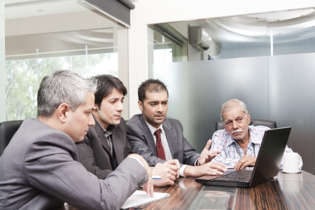 A diversed group of young business executives having a meeting with a senior executive Stock Photo - 14292926