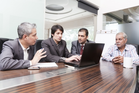 A diversed group of young business executives having a meeting with a senior executive