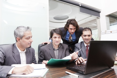 group of young multiracial businessmen in a meeting photo
