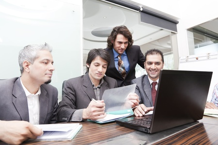 Boardroom meeting: group of young multiracial businessmen in a meeting Stock Photo