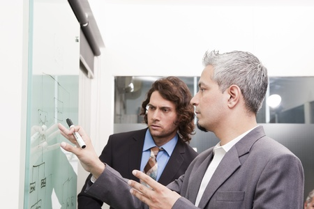 young businessman giving presentation to his colleagues photo