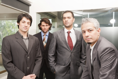 Group of businessmen in office, group of young executives photo