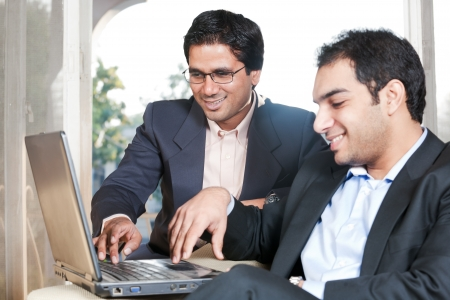 two Indian businessmen in meeting, two businessmen working on the laptop photo