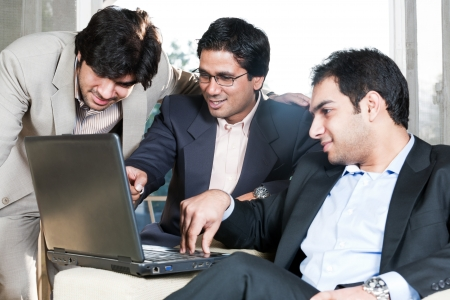group of multi ethnic businessmen, indian businessman in a meeting with his colleagues Stock Photo