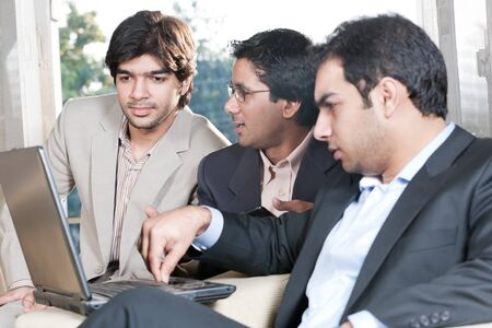 group of multi ethnic businessmen, indian businessman in a meeting with his colleagues photo