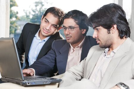 group of multi ethnic businessmen, indian businessman in a meeting with his colleagues Stock Photo - 14336700