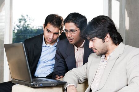 group of multi ethnic businessmen, indian businessman in a meeting with his colleagues Stock Photo - 14336701