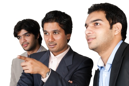 Indian business team, business team looking and pointing towards left side out of frame photo