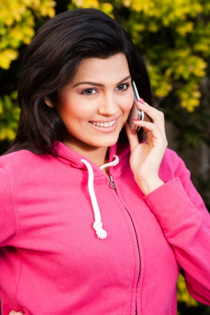 portrait of a happy smiling beautiful girl talking on her mobile phone  Stock Photo - 14431035