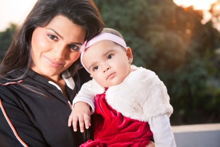 Indian family, portrait of Indian mother with little baby girl in outdoors Stock Photo