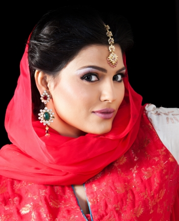 portrait of a beautiful muslim bride in red dress photo