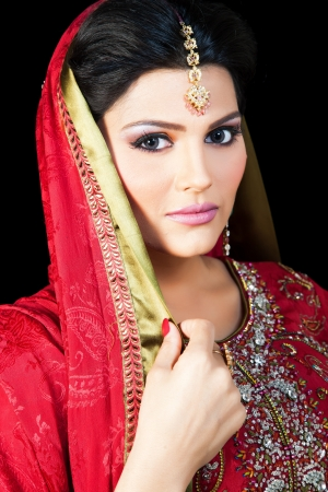 Muslim Indian bride wearing a red bridal dress, portrait of a beautiful Indian bride photo