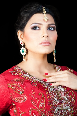 Muslim Indian bride wearing a red bridal dress, portrait of a beautiful Indian bride Stock Photo - 14431049