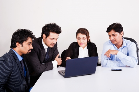 group of multi racial business people in meeting, Inidan business woman in meeting with young businessmen. Stock Photo - 14490468