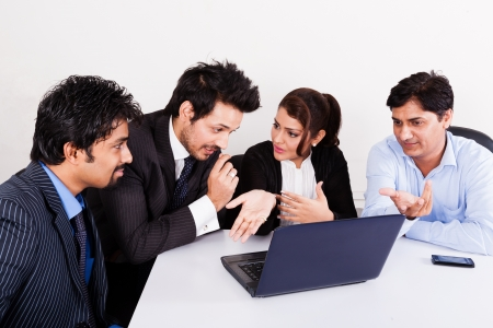 board room: group of multi racial business people in meeting, Inidan business woman in meeting with young businessmen.