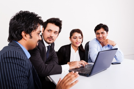 enterprising: group of multi racial business people in meeting, Inidan business woman in meeting with young businessmen.