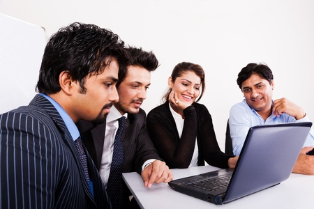 group of multi racial business people in meeting, Inidan business woman in meeting with young businessmen. photo