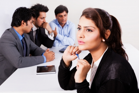 portrait of a confident businesswoman with her colleagues in the background photo