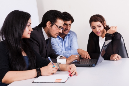 group of multi racial business people in meeting, Inidan business woman in meeting with young businessmen  Stock Photo