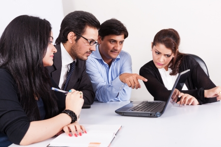 corporate meeting: group of multi racial business people in meeting, Inidan business woman in meeting with young businessmen  Stock Photo