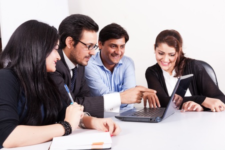 enterprising: group of multi racial business people in meeting, Inidan business woman in meeting with young businessmen  Stock Photo