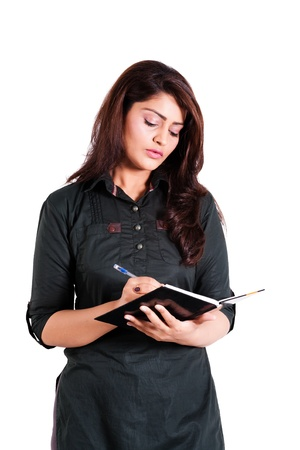 confident indian businesswoman holding note book photo