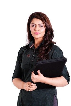 south indian: cofident businesswoman holding laptop isolated on white  Stock Photo