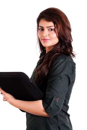 south asian ethnicity: cofident businesswoman holding laptop isolated on white  Stock Photo
