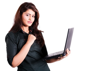 south asian ethnicity: businesswoman using laptop with copy spcae, confident businesswoman using laptop isolated on white,  Stock Photo