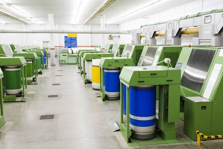 roving: row of textile machines Stock Photo