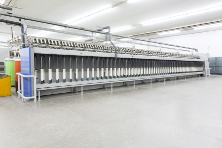 yarn spinning machine in textile factory  photo