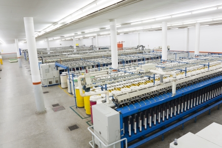 spinning factory: row of textile machines Stock Photo