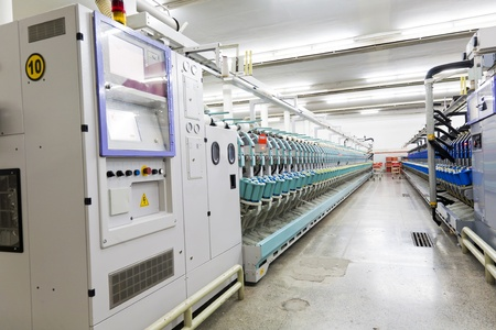 polyester: yarn spinning machine in textile factory