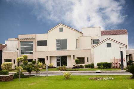 model home against blue sky photo
