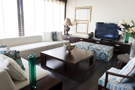 center table: modern interior desing living room with white sofa and brown center table