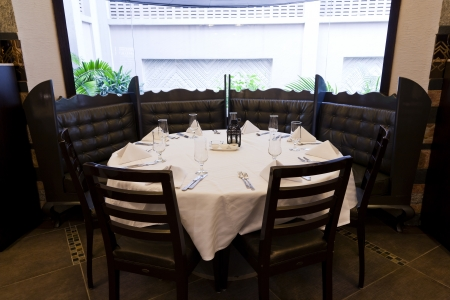 business dinner: round dining table in the corner of a restaurant