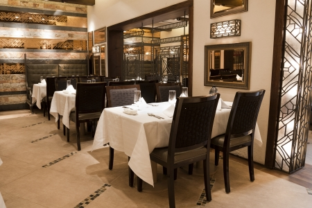 dining table and chairs: interior of a modern design restaurant