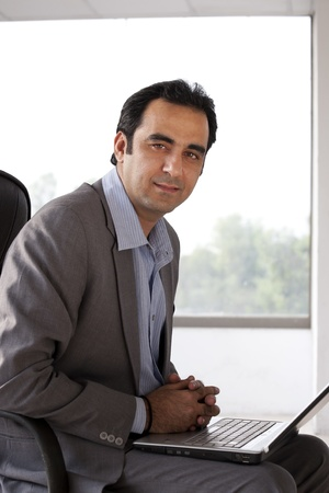 Indian businessman with laptop photo