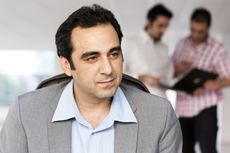 close up of a businessman with colleagues in background photo