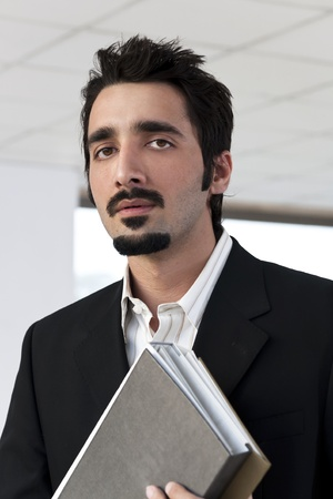 Indian businessman with office files  photo