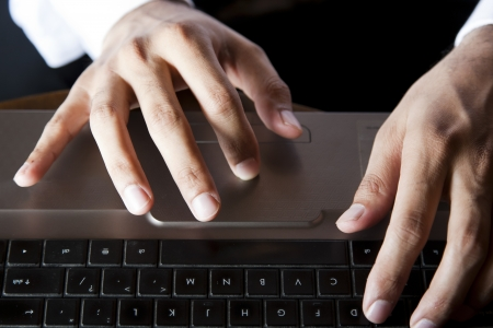 key punching: close up of a businessman,s hands Stock Photo