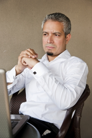 portrait of a handsome businessman with grey hair working on the laptop, Indian muslim businessman working  photo