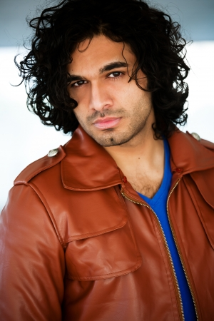 rugged man: portrait of a confident man with afro hair style, Stock Photo