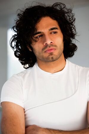 portrait of happy confident man with curly hair,