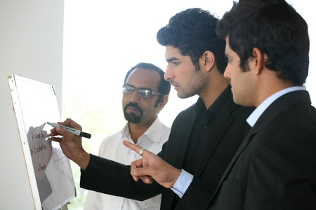 small group of businessmen in meeting photo