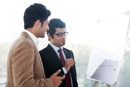 two businessmen discussing business strategy in a meeting, Indian business man with latin american colleague Stock Photo - 14863336