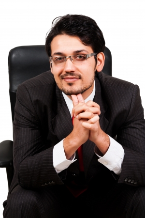 happy businessman sitting in office chair photo
