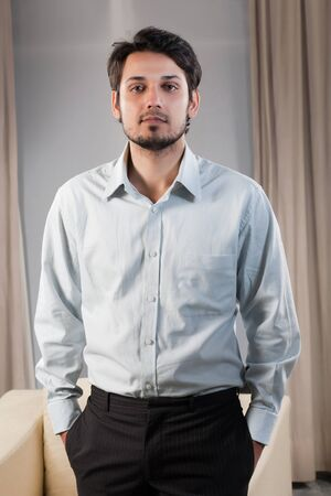 american banker: portrait of a handsome mixed race businessman