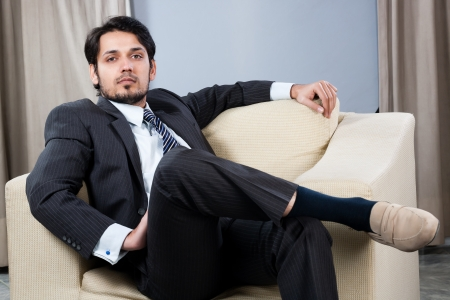 Indian businessman relaxing on the sofa photo