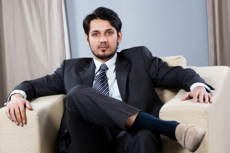 confiden businessman sitting on a sofa photo